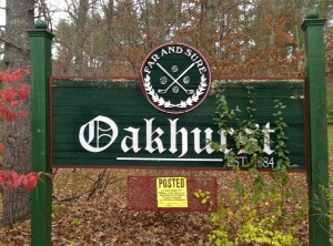 Oakhurst's welcome sign is somewhat hidden in the woods and not really close to the road leading to the clubhouse.