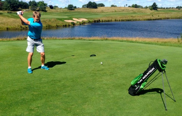 A tee shot over water was no problem for Eri Crum on the Glen Club's 18th hole.